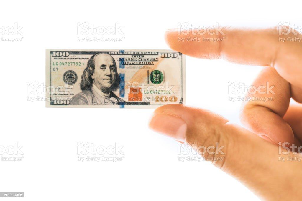 Frau Hand mit klein amerikanische Dollar-banknote Lizenzfreies stock-foto