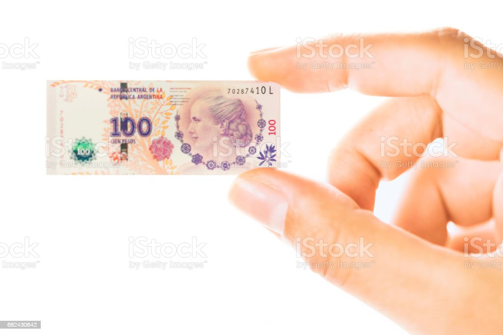 Woman hand holding small size Argentina peso banknote royalty-free stock photo