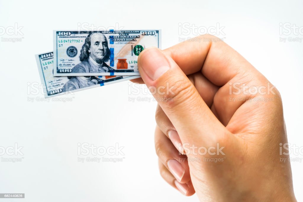 Woman hand holding small size paper banknotes of American dollar royalty-free stock photo