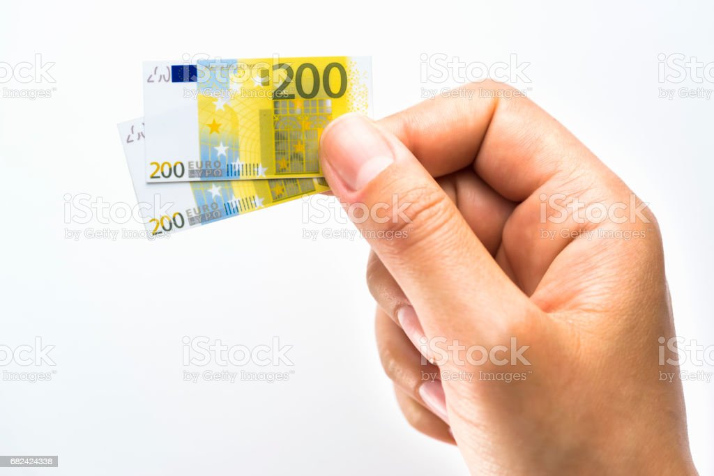 Woman hand holding small size paper banknotes of Euro royalty-free stock photo