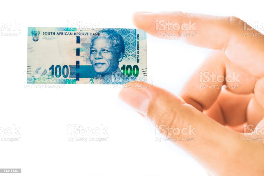 Woman hand holding small size South African rand banknote stock photo