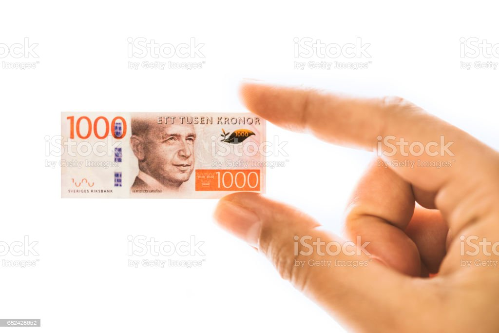 Woman hand holding small size Swedish krone banknote royalty-free stock photo