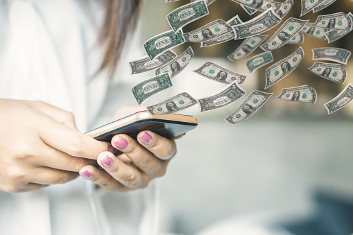 Woman Hand Holding Smart Phone Transfer Money Online Stock Photo - Download Image Now