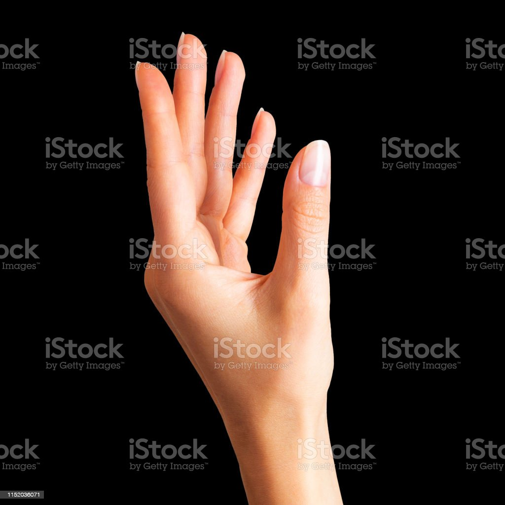 Woman beautiful hands showing somethin on black background. Spa, soft...