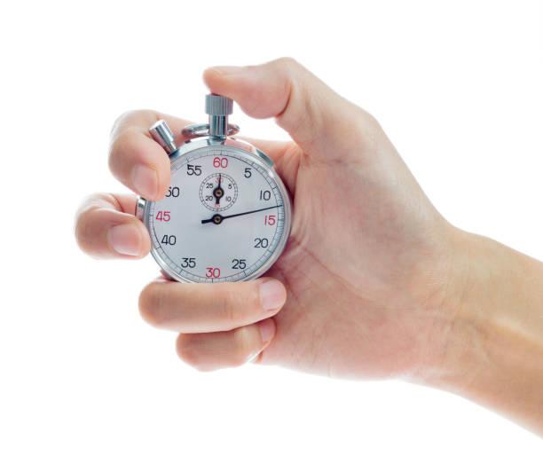 vrouw hand met stopwatch op witte achtergrond - stopwatch stockfoto's en -beelden