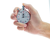 istock Woman hand holding stopwatch on white background 1141338799