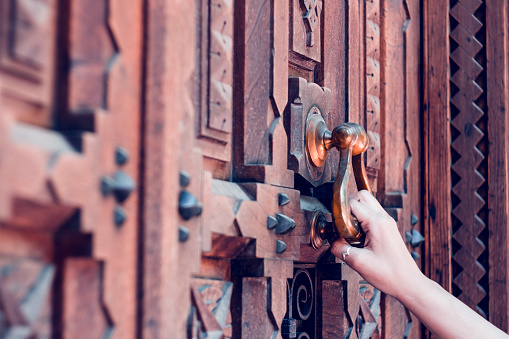 Woman Hand Holding Vintage Old Door Knocking Stock Photo - Download Image Now