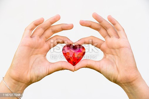 823097608istockphoto woman hand holds red heart. 1167077048