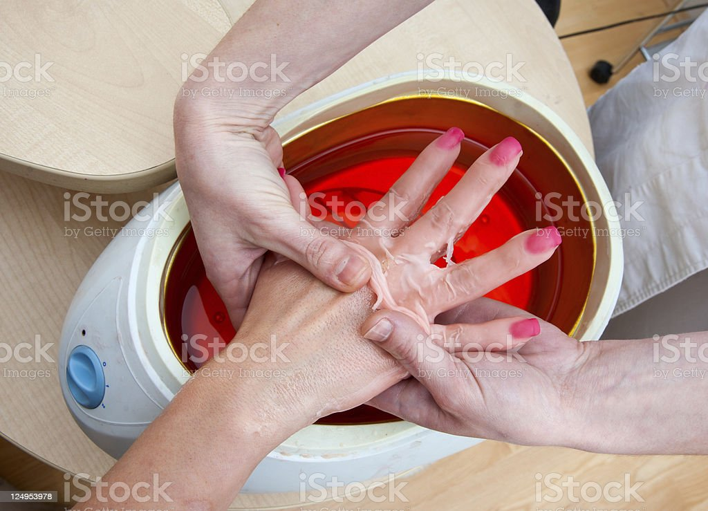 woman hand in paraffin bath royalty-free stock photo