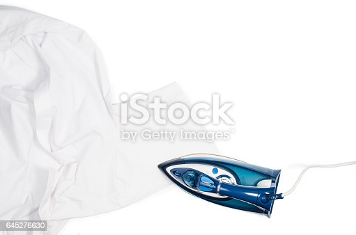 645276668 istock photo Woman hand ironing clothes top view isolated on white background 645276630