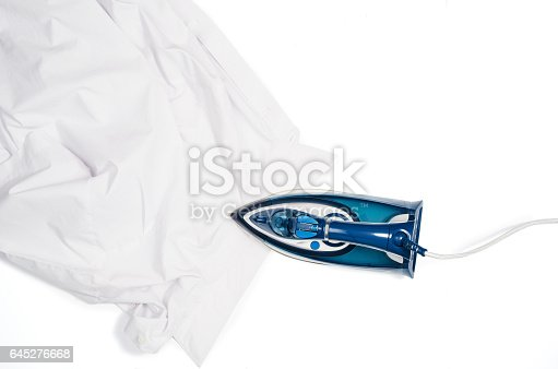 645276668 istock photo Woman hand ironing clothes top view isolated on white background 645276668