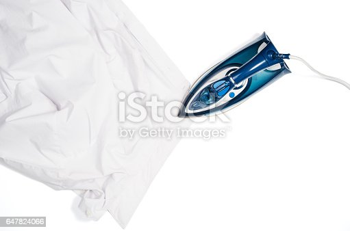 645276668 istock photo Woman hand ironing clothes top view isolated on white background 647824066