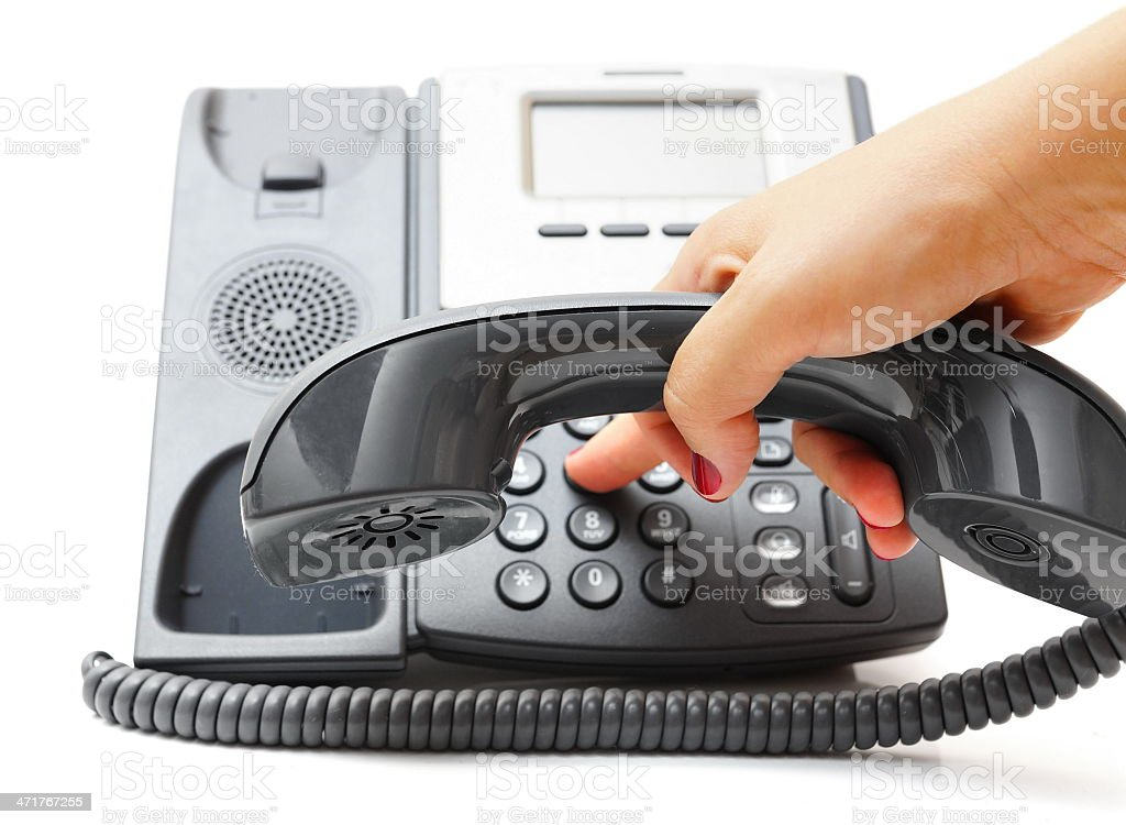 woman hand is dialing a phone number royalty-free stock photo