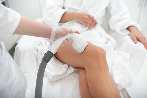 Woman hand making hair removal stock photo