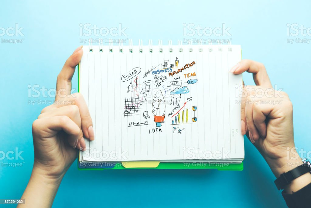 woman hand notepad on blue background stock photo