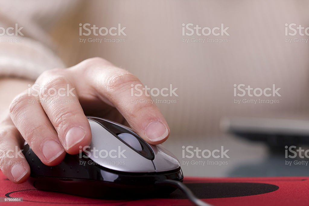 Woman hand on a mouse royalty-free stock photo