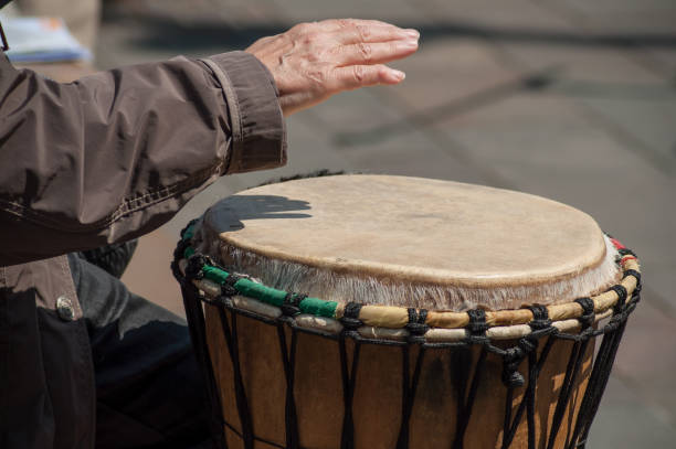 woman hand on african drums in outdoor stock photo