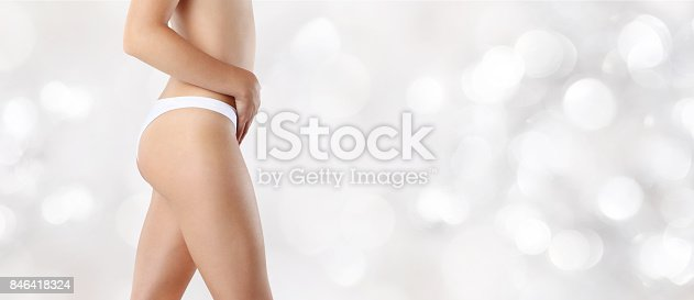 istock woman hand on belly, isolated on silver background, body care concept 846418324