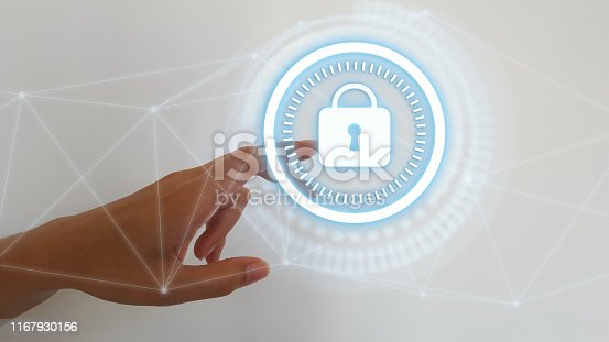 istock Woman hand on blurred background touching digital padlock security interface to protect datas 1167930156