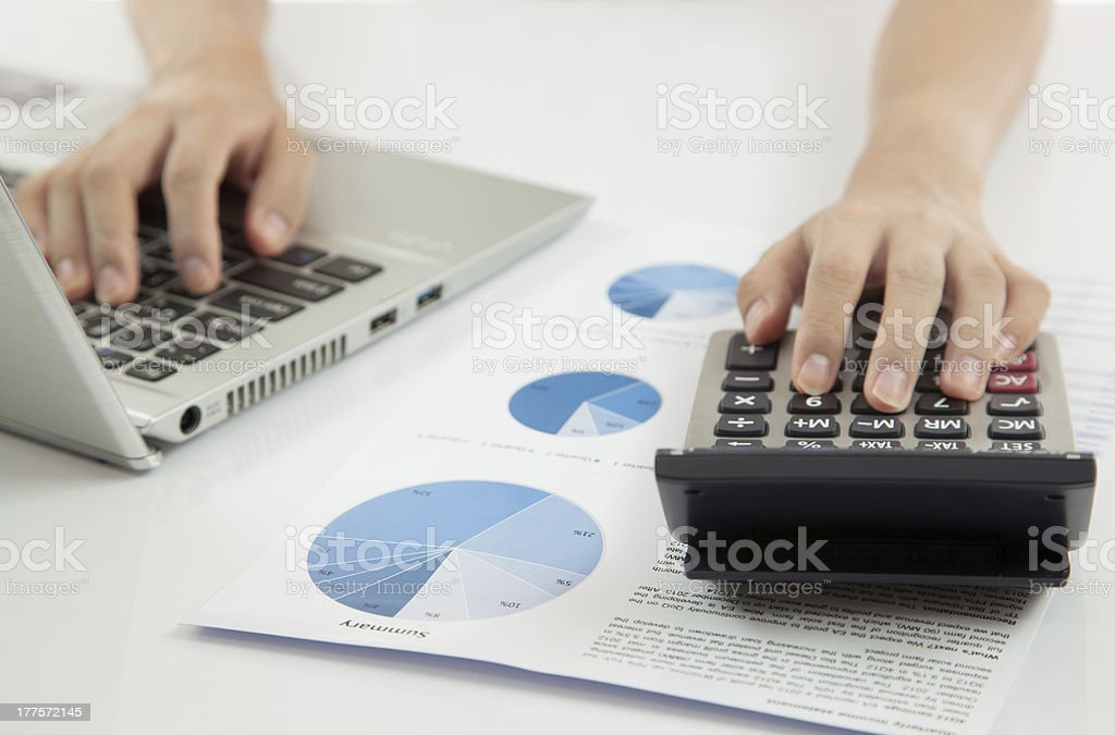 woman hand on laptop with business report royalty-free stock photo