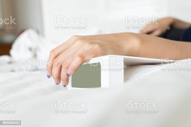 Woman hand on white digital alarm clock in bedroom picture id895566452?b=1&k=6&m=895566452&s=612x612&h=ylqkd9buku zl5pui9jgw1aiosfgwf0yhisfudhoxye=