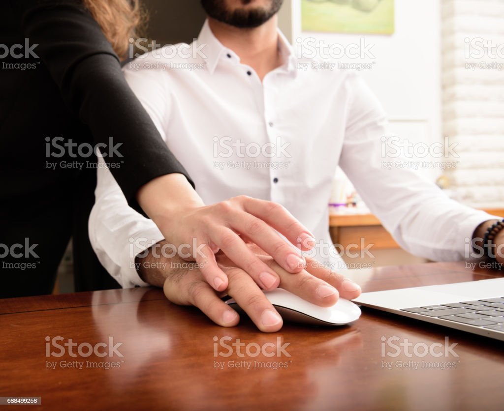 Woman hand on working mans. - foto stock