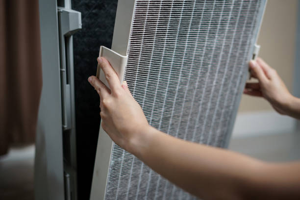 Woman hand open air purifier for clean dirty air purifier HEPA filter. Woman hand open air purifier for clean dirty air purifier HEPA filter. air filter stock pictures, royalty-free photos & images