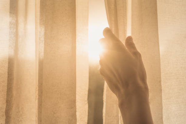 woman hand opening curtains in the bedroom - open window imagens e fotografias de stock