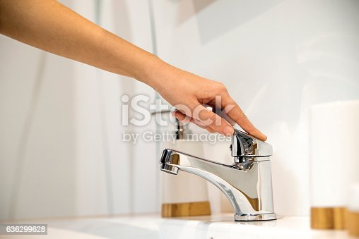 istock Woman Hand Operating Faucet 636299628