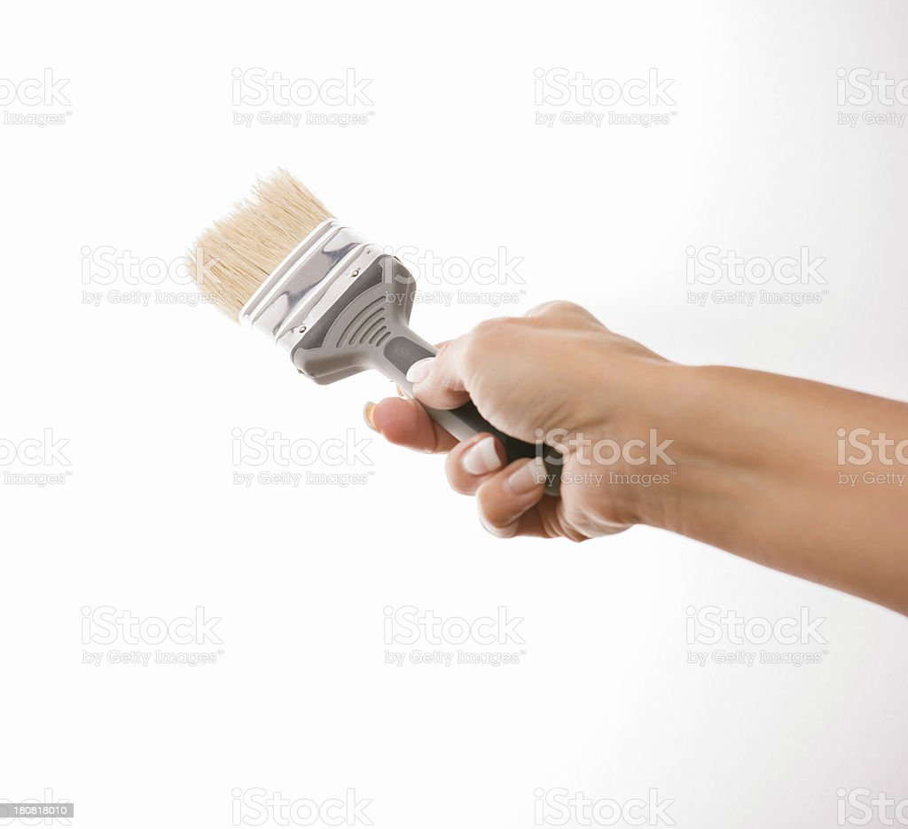Woman hand painting with new paint brush on white royalty-free stock photo