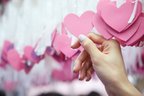 Woman hand pick pink heart shape lucky draw attached to white ribbon picture id1081233402?b=1&k=6&m=1081233402&s=612x612&w=0&h=ibcs6suokj86kklptv3gvgo6qt8alf21y43qdhewt5o=