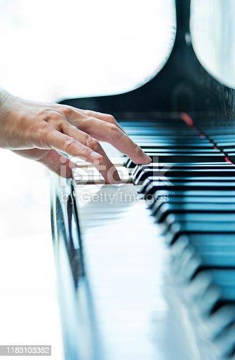 Woman hand playing piano