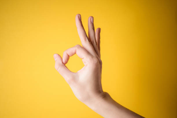 woman hand pointing gesture okay stock photo