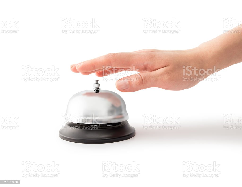 Woman hand pressing a hotel service bell stock photo