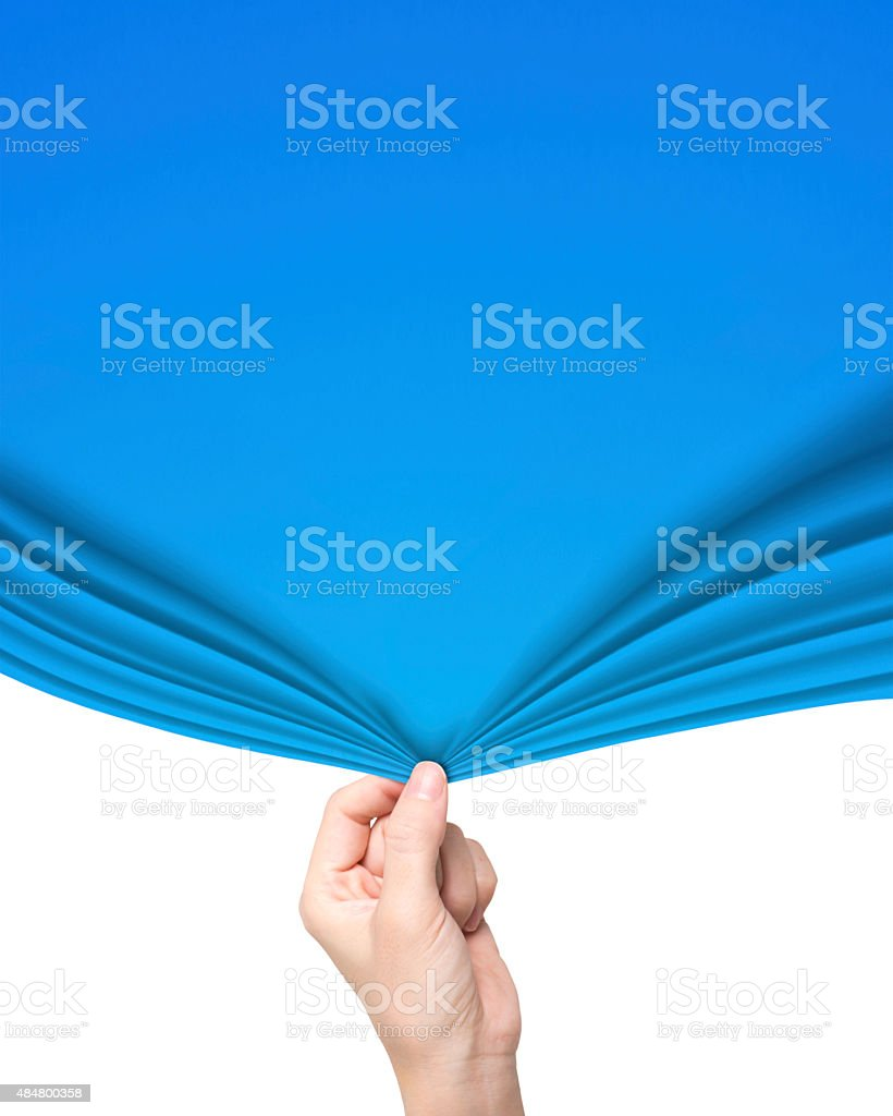 Woman hand pulling open blue curtain covering blank white stock photo