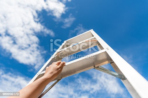 istock Woman Hand Reaching For Red Ladder Leading To A Blue Sky Step by Step. Development Attainment Motivation Career Growth Concept. 988896170