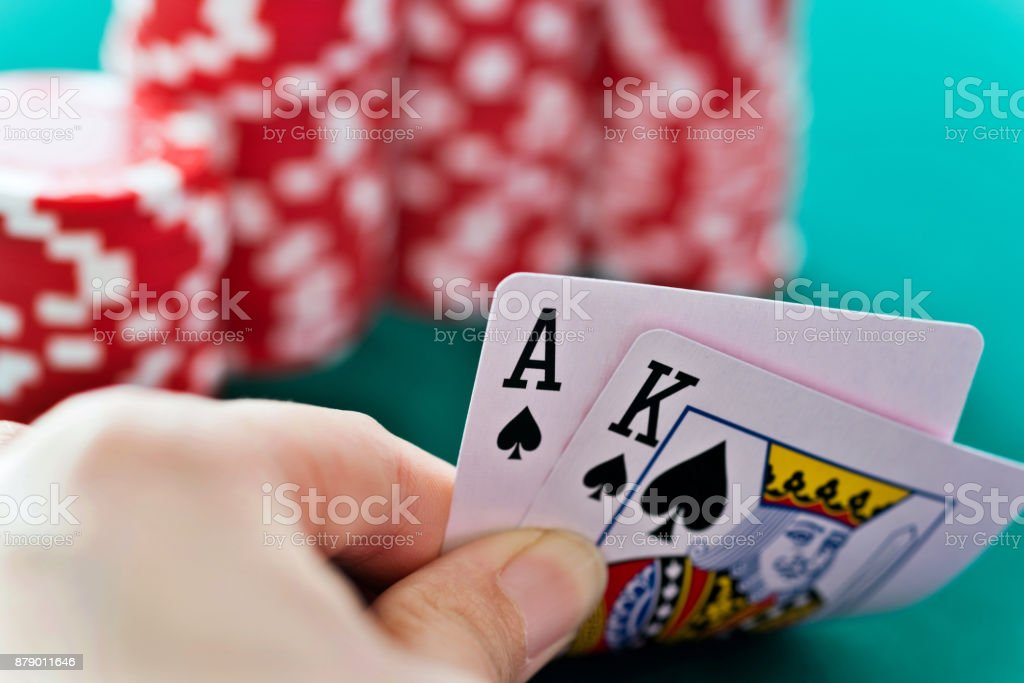 Woman hand revealing aces and king card stock photo