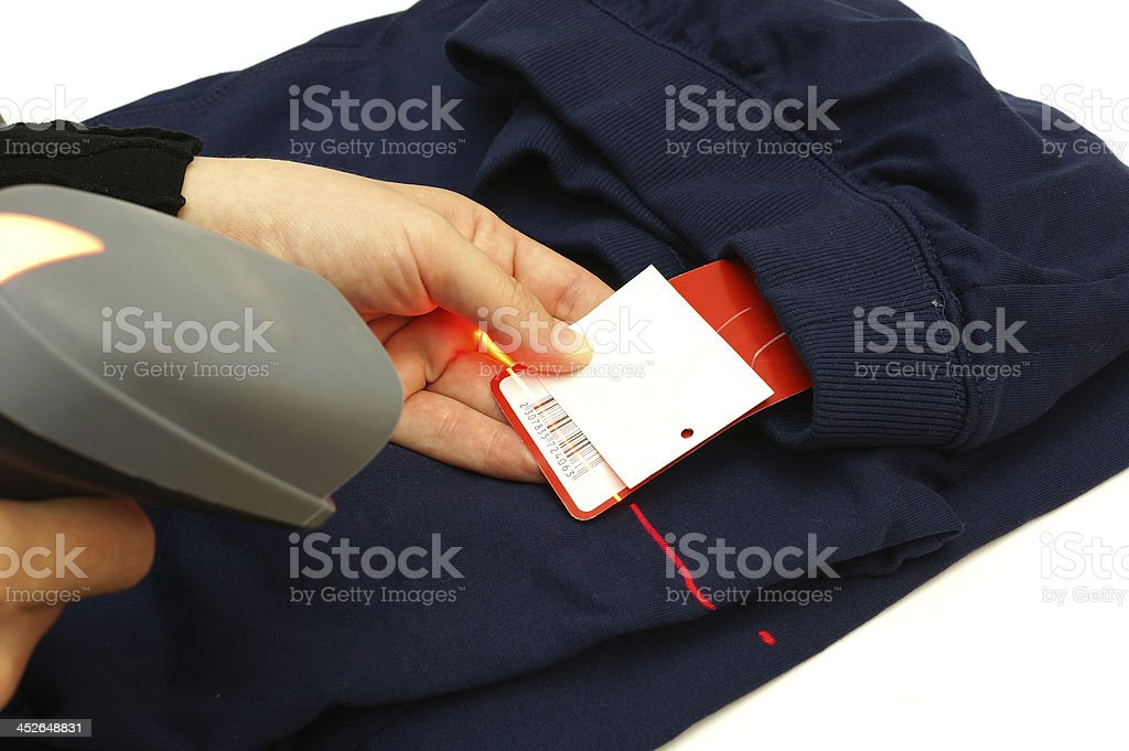 Woman hand scan bar code on clothing stock photo