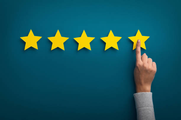 Woman hand showing on five star excellent rating Customer Experience Concept. Woman hand showing on five star excellent rating on background, copy space adulation stock pictures, royalty-free photos & images
