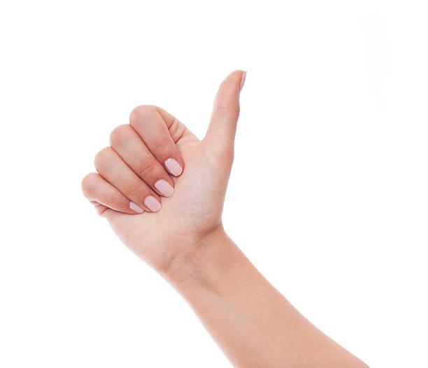 donna mano mostrando il pollice in alto su bianco - mano donna dita unite foto e immagini stock