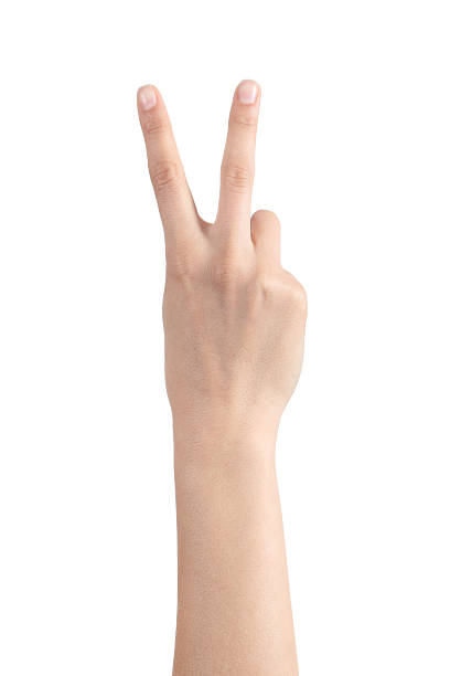 woman hand showing two fingers - symbols of peace stock pictures, royalty-free photos & images