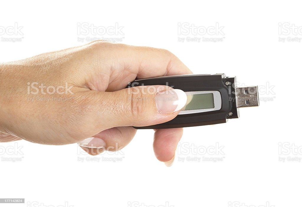 Woman hand showing USB flash storage mp3 player on white royalty-free stock photo