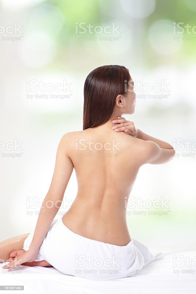 woman hand touch her shoulder royalty-free stock photo