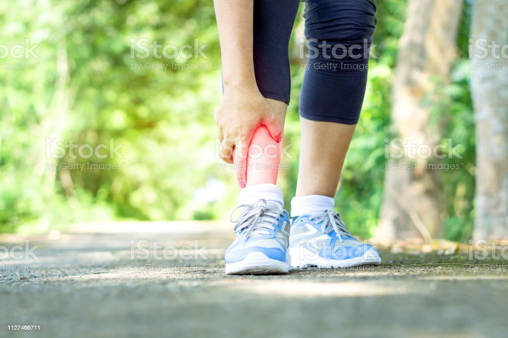Woman Hand Touching Her Leg Pain Twisted Ankle Broken Stock