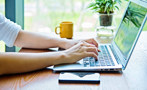 woman hand typing on laptop - human finger stock pictures, royalty-free photos & images