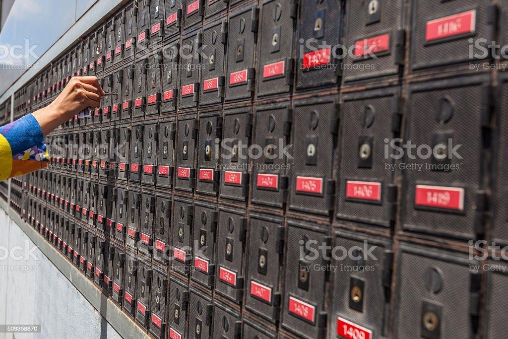 woman hand unlocking po box stock photo