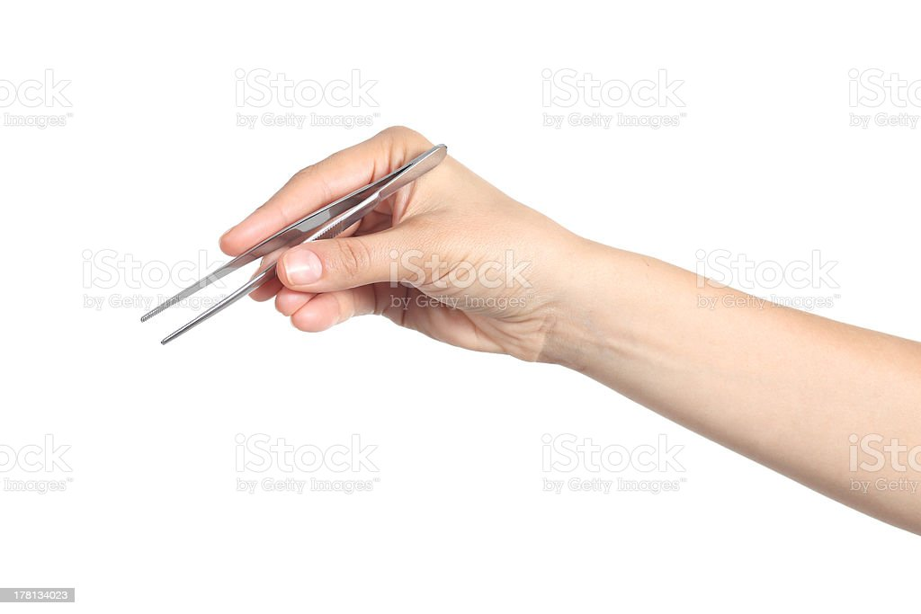 Woman hand using a tweezers stock photo