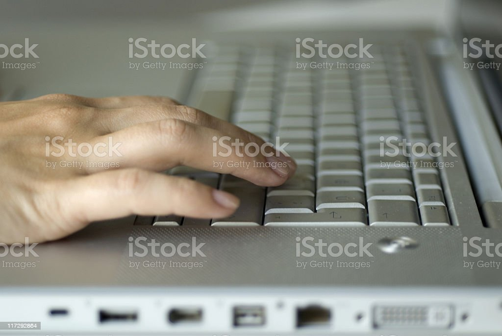 Woman hand using laptop, close-up royalty-free stock photo