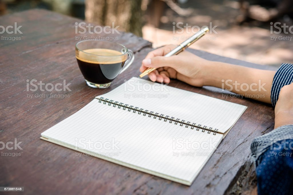 Woman hand using laptop computer on wooden table royalty-free stock photo