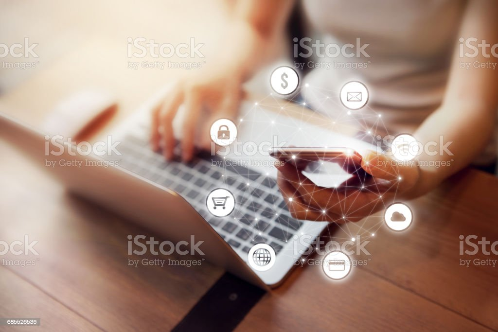 Woman hand using mobile payments online shopping stock photo